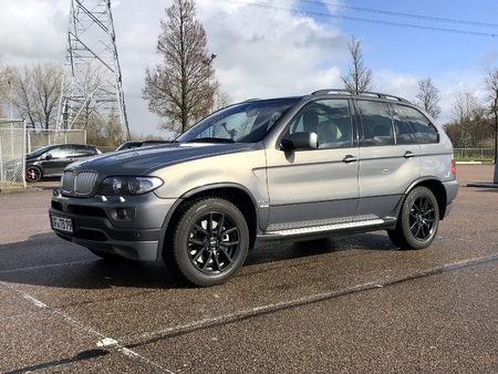 Diemen, the Netherlands - March 8, 2019: BMW X5 parked on a public parking lot. Nobody in the vehicle.