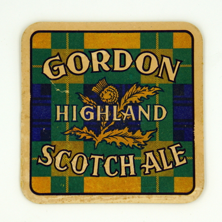 Amsterdam, the Netherlands - March 12, 2019: 1980s vintage Gordon Scotch Ale bear mat or coaster against a white background.