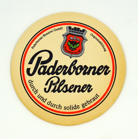 Amsterdam, the Netherlands - March 15, 2019: 1980s vintage German Paderborn beer bear mat or coaster against a white background. Redactioneel