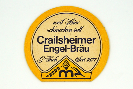Amsterdam, the Netherlands - March 15, 2019: 1980s vintage Crailsheimer Engel Brau beer mat or coaster against a white background.