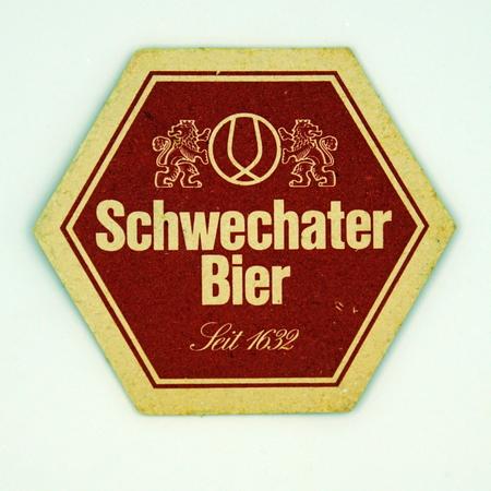 Amsterdam, the Netherlands - March 8, 2019: 1980s vintage Schwechater Beer beer mat or coaster. Redactioneel