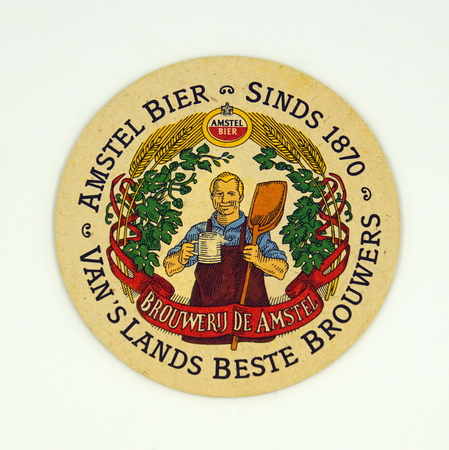 Amsterdam, the Netherlands - March 15, 2019: 1980s vintage Amstel Beer bear mat or coaster against a white background. Redactioneel