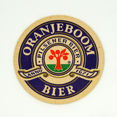 Amsterdam, the Netherlands - March 15, 2019: 1980s vintage Orange tree Royal beer mat or coaster against a white background.