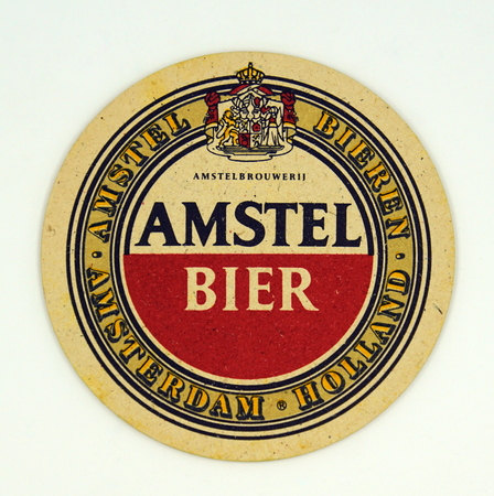Amsterdam, the Netherlands - March 15, 2019: 1980's vintage Amstel Beer bear mat or coaster against a white background. Stockfoto - 122440921