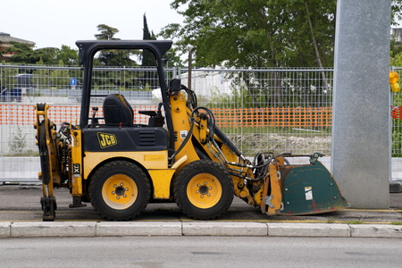 Verona, Italy - April 29, 2019: JCB 1XC road construction vehicle by the side of the road.