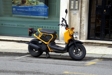 Verona, Italy - April 29, 2019: Yellow Honda Zoomer parked by the side of the road. Editorial