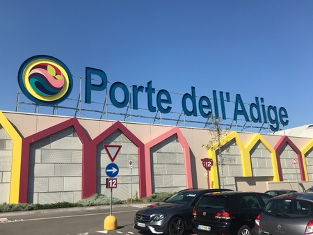 Bussolengo, Verona, Italy - April 20, 2019: Entrance logo of Porte delladige Italian Shopping Center in Verona.