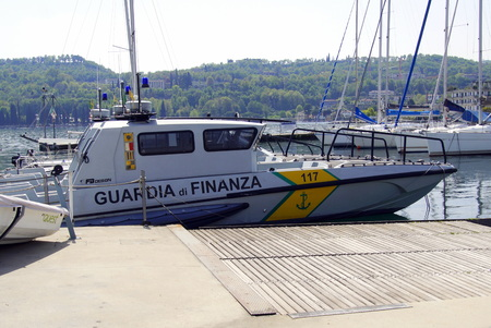 Salo, Italy - April 22, 2019: Docked speedboat of the Guardia di Finanza, an Italian economic and financial law enforcement agency. Editorial