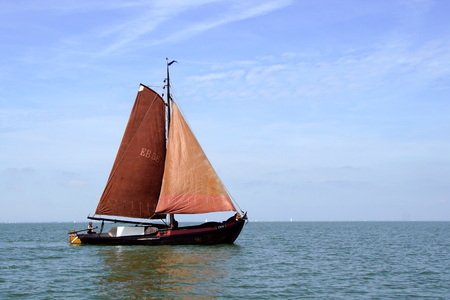 Almere, the Netherlands - June 1, 2019: Historic Dutch Botter EB58 sailing on a sunny day. Editorial