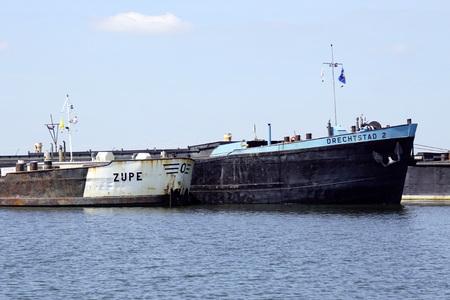 Almere the Netherlands - June 1, 2019: The bows of Dutch inland waterway motor freighters Zijpe and Drechtstad 2 docked.