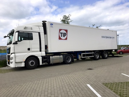 Almere, the Netherlands - May 31, 2019: Tip transport truck and trailer parked by the side of the road.