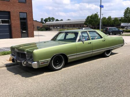 Woerden, the Netherlands - June 22, 2019: Green Chrysler New Yorker parked by the side of the road. Nobody in the vehicle. Editorial