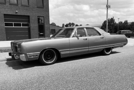 Woerden, the Netherlands - June 22, 2019: Chrysler New Yorker parked by the side of the road. Nobody in the vehicle.