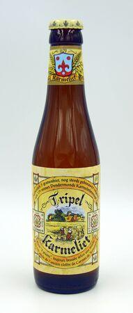 Amsterdam, the Netherlands - June 8, 2019: Bottle of Tripel Carmelite, a Tripel styled beer brewed by Brouwerij Bosteels.