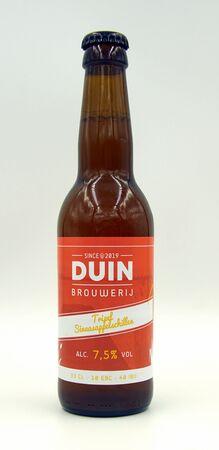 Almere Duin, the Netherlands - July 7, 2019: Bottle of Duin Tripel Orange peels, brewed by Dutch Duin Brewery.
