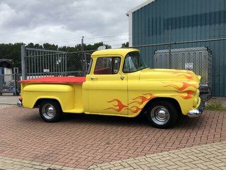 Almere, the Netherlands - July 8, 2019: Yellow Chevrolet Pickup parked by the side of the road. Nobody in the vehicle.