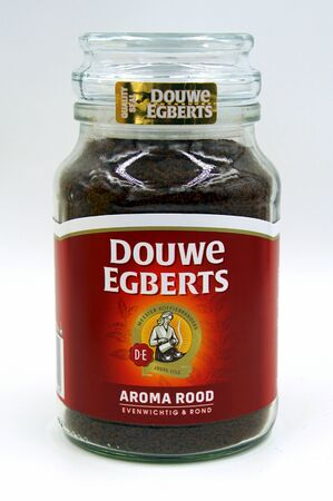 Amsterdam, the Netherlands - July 13, 2019: Package of Douwe Egberts aroma red instant coffee against a white background.