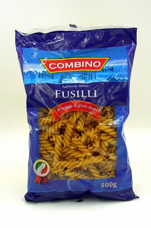 Amsterdam, the Netherlands - July 13, 2019: Package of Combino Fusilli against a white background.