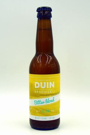 Almere Duin, the Netherlands - July 13, 2019: Bottle of Duin Bitter Blond beer, brewed by Dutch Duin Brewery.
