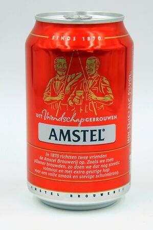 Amsterdam, the Netherlands - July 14, 2019: Can of Dutch Amstel beer against a white background.