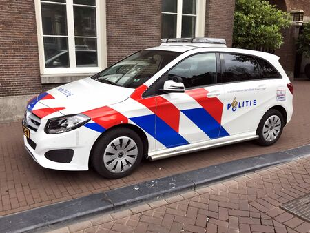 Amsterdam, the Netherlands - July 15, 2019: Dutch national police car parked by the side of the road. Nobody in the vehicle.