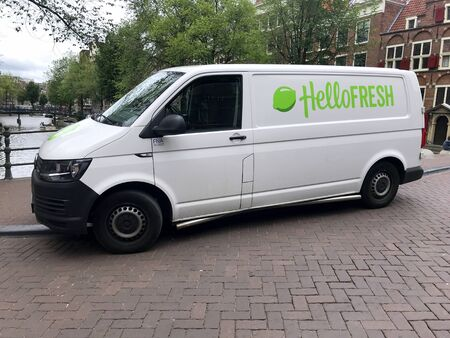 Amsterdam, the Netherlands - July 15, 2019: White Volkswagen Transporter Hello Fresh delivery from parked by the side of the road. Nobody in the vehicle. Editorial