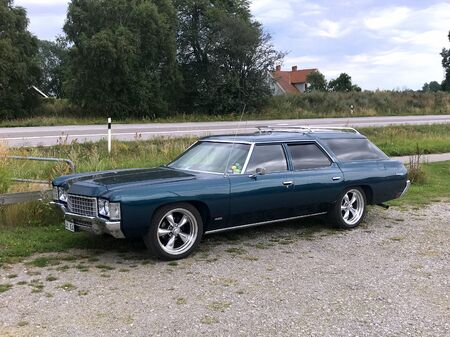 Lyckeby, Sweden - July 27, 2019: Green Chevrolet Impala parked by the side of the road. Nobody in the vehicle.