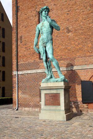 Copenhagen, Denmark - July 20, 2019: Public bronze replica or Michelangelos David statue at the Langelinie Promenade in Copenhagen, Denmark.