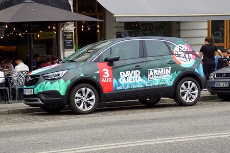 Malmo, Sweden - July 22, 2019: Promotion car for Swedish Big Slap Festival advertising DJs Armin van Buuren and David Guetta, parked by the side of the road. nobody in the vehicle.