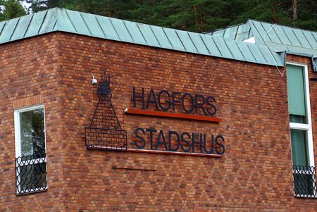 Hogfors, Sweden - August 4, 2019: Wall logo of the town hall of Hagfors, Sweden.