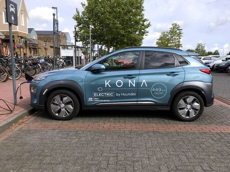 Lelystad, the Netherlands - September 1, 2019: Hyundai KONA Electric being charged on a public parking lot. Nobody in the vehicle.