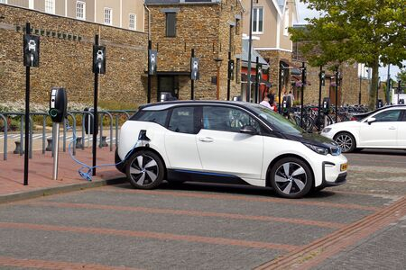 Lelystad, the Netherlands - September 1, 2019: BMW i3 electric car being charged on a public parking lot. Nobody in the vehicle.