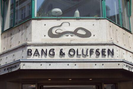 Copenhagen, Denmark - July 20, 2019: Wall sign of Bang & Olufsen, a high-end luxury Danish consumer electronics company.