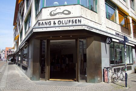 Copenhagen, Denmark - July 20, 2019: Entrance and wall sign of Bang & Olufsen, a high-end luxury Danish consumer electronics company.