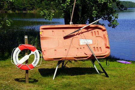 Asarum, Sweden - July 25, 2019: Swedish life raft by the side of a lake.