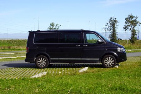 Almere, the Netherland - September 20, 2019: Black Volkswagen Transporter surveillance  private detective of with blinded windows parked on a public parking lot. Redactioneel