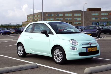 Almere, the Netherland - September 20, 2019: Mint green Fiat 500 parked in a public parking spot in the city of Almere. Nobody in the vehicle. Redactioneel