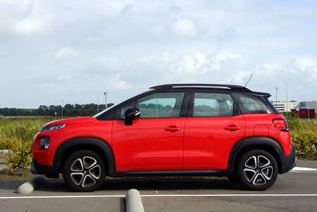 Almere, the Netherland - September 20, 2019: Red Citroen c3 aircross parked on a public parking lot. Nobody in the vehicle.