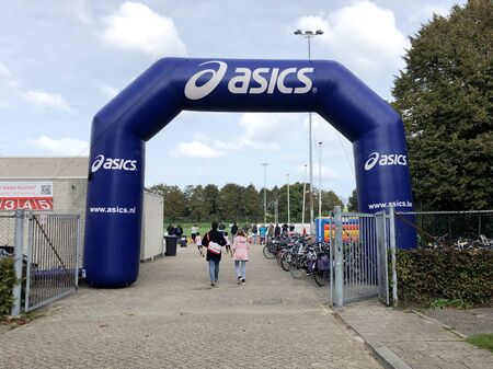Almere, the Netherlands - October 5, 2019: Blue Asics inflatable start or finish arch.