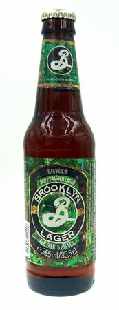 New York, United States - October 9, 2019: Bottle of Brooklyn Lager, an Amber styled Lager brewed by Brooklyn Brewery. Redactioneel