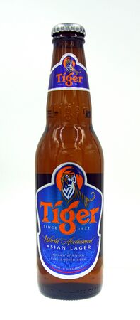 Amsterdam, the Netherland - October 9, 2019: Bottle of Tiger Beer, a Pale Lower styled beer brewed by Singapore Brewery (Asia Pacific Breweries-Heineken).