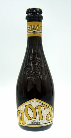 Piozzo, Italy - October 9, 2019: Bottle of Baladin Nora, a Traditional styled beer, brewed by Le Baladin. Editorial