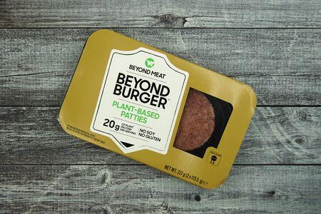 Zaandam, the Netherlands - December 20, 2019: Package of Beyond Burger against a wooden background. Stockfoto - 136012293