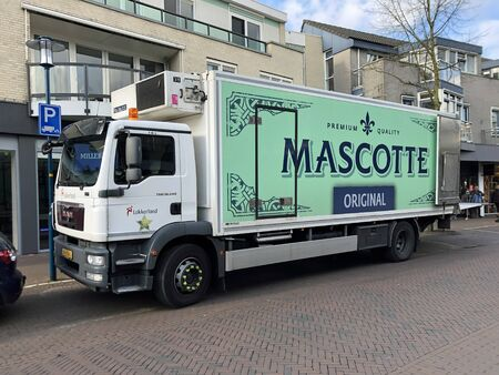 Epe, the Netherlands - February 19, 2020: Mascotte delivery truck parked by the side of the road. Nobody in the vehicle.