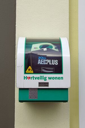 Hattem, the Netherlands - February 20, 2020: Dutch Aed plus defibrillator mounted in a wall. Editorial