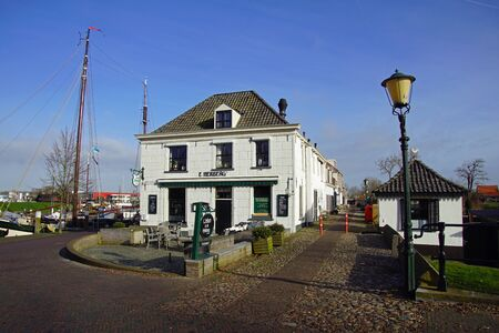 Elburg, the Netherlands - February 21, 2020: Part of the city harbor of Elburg.