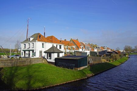 Elburg, the Netherlands - February 21, 2020: Traditional Dutch dyke houses in the town of Elburg.