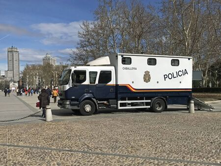 Madrid, Spain - February 25, 2020: Spanish police horse truck parked by the side of the road. Nobody in the vehicle.
