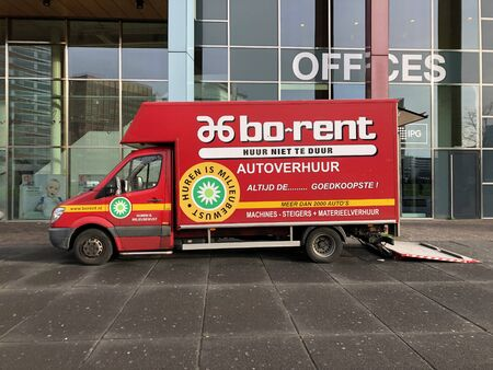 Amsterdam, the Netherlands - February 28, 2020: Red bo-rent rental van parked by the side of the road.