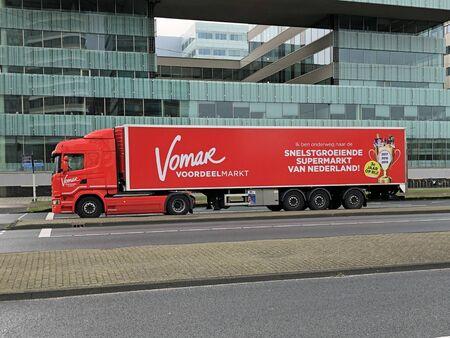 Amsterdam, the Netherlands - February 28, 2020: Red Vomar transport truck.